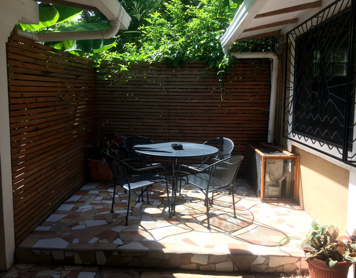 Outdoor space shared with one other room