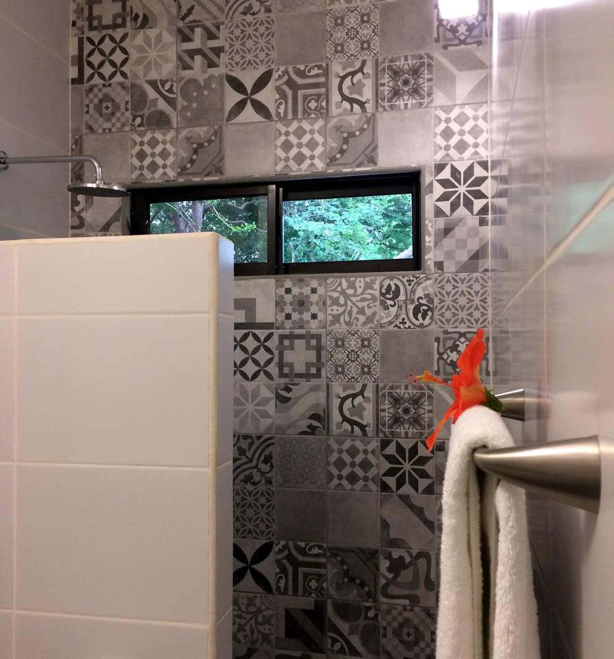 Beautiful fully tiled bathroom with an abundance o